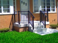 6)  2 rise (14″ tall) 4′ wide, with a 15″ deep top tread & custom built to fit Series 900 Superior Aluminum Railings on porch & step.