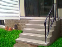 4)  5 rise, ( 35″ tall )  with a 15″ deep top tread, & standard 30″ tall Iron Railing.